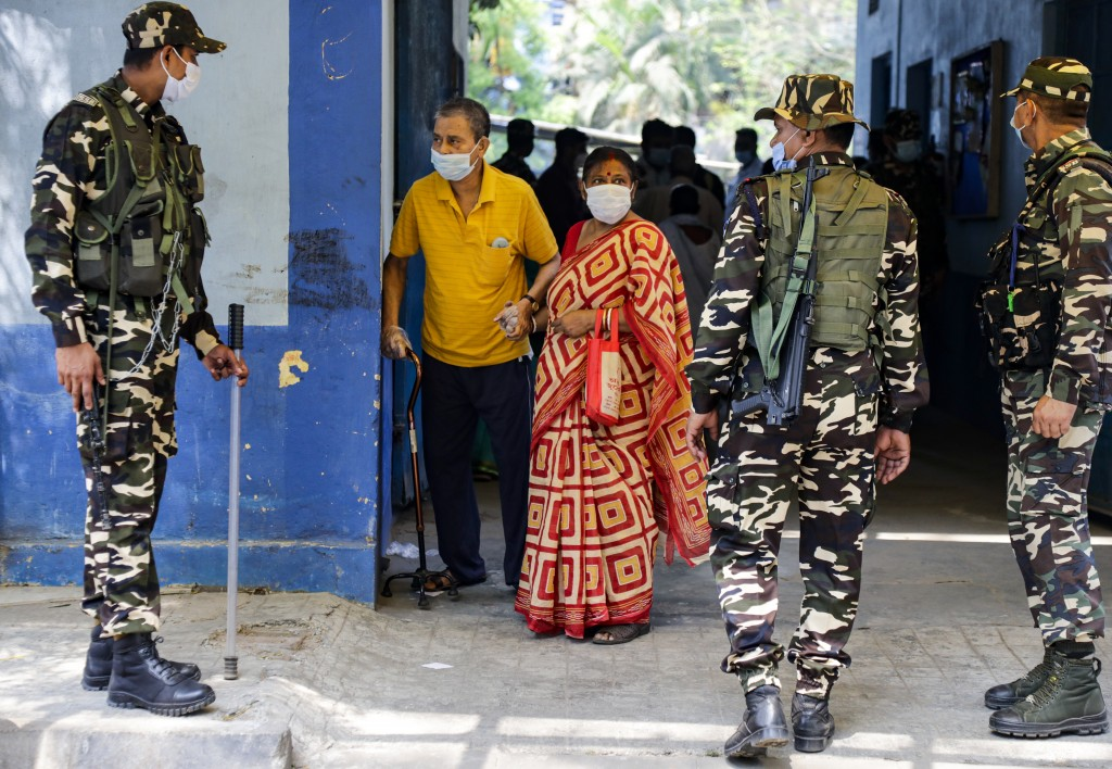 Voters leave a polling station after casting their votes during the fourth phase of West Bengal state elections in Kolkata, India, Saturday, April 10,...