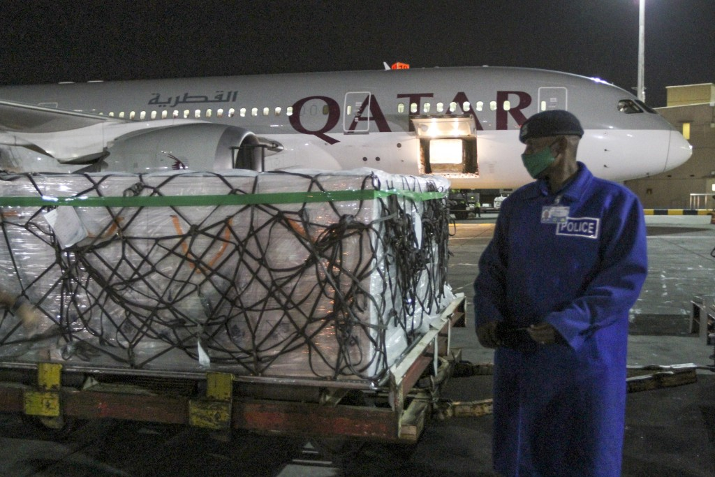 FILE - In this March 3, 2021, file photo, the first arrival of COVID-19 vaccines to Kenya is offloaded from a Qatar Airways flight at Jomo Kenyatta In...
