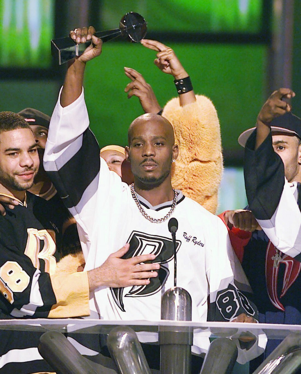 FILE - DMX, center, accepts the R&B Album Artist of the Year during the 1999 Billboard Music Awards in Las Vegas, on Dec. 8, 1999. The family of rappe...
