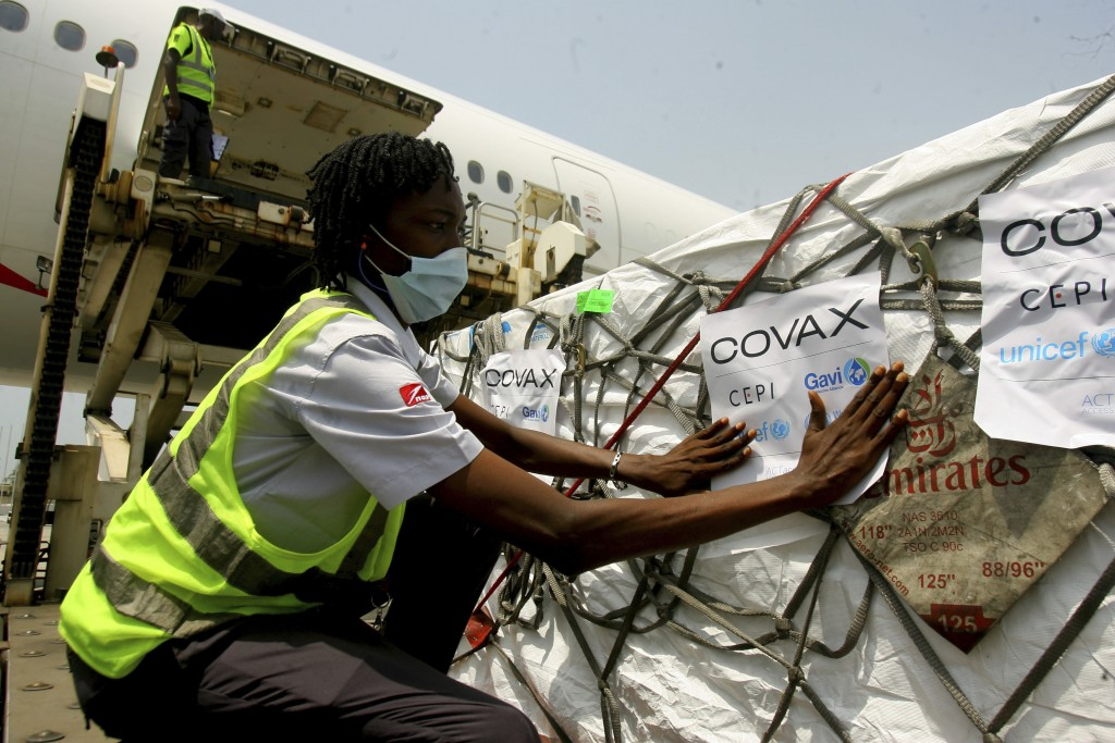FILE - In this Feb. 25, 2021, file photo, a shipment of COVID-19 vaccines distributed by the COVAX global initiative arrives in Abidjan, Ivory Coast. ...