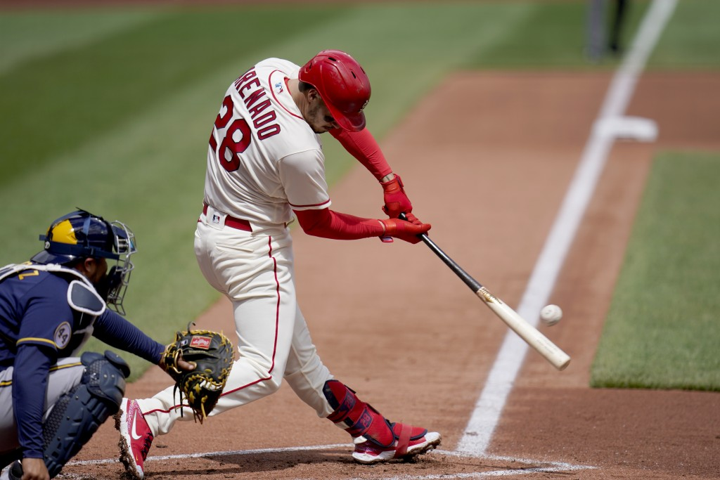 St. Louis Cardinals' Nolan Arenado doubles down the line during the first inning of a baseball game against the Milwaukee Brewers Saturday, April 10, ...