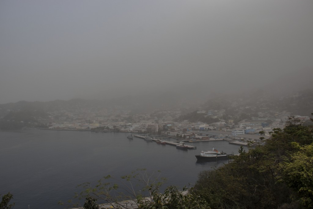 A cloud of volcanic ash hovers over Kingstown, on the eastern Caribbean island of St. Vincent, Saturday, April 10, 2021, a day after the La Soufriere ...