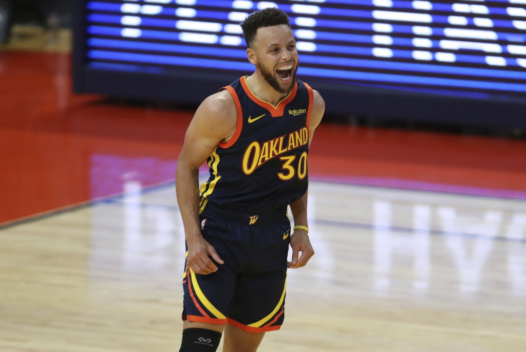 Golden State Warriors guard Stephen Curry yells after making a 3-point shot against Houston Rockets during the second half of an NBA basketball game i...