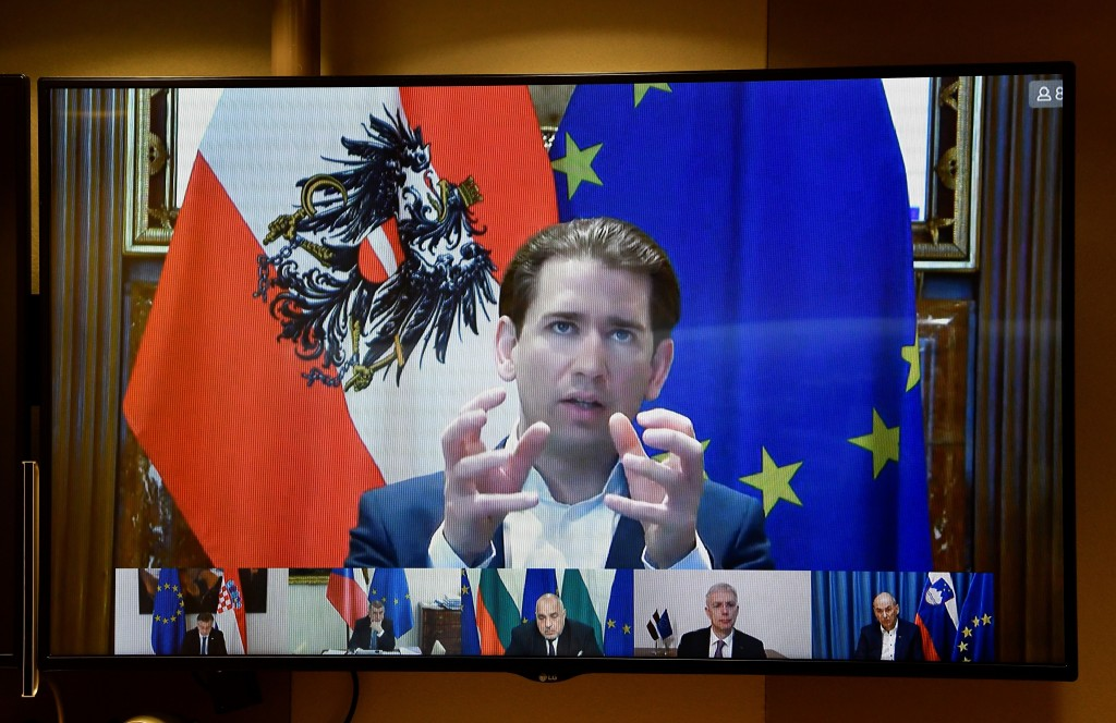 FILE - In this March 17, 2021, file photo, Austria's Chancellor Sebastian Kurz speaks to European Council President Charles Michel via a video confere...