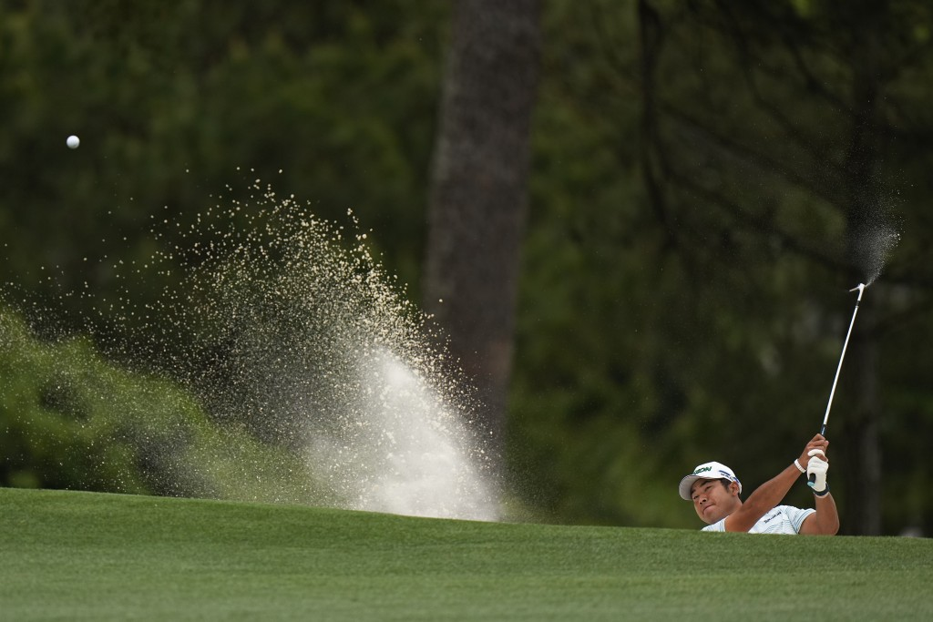 Hideki Matsuyama, of Japan, hits out of a bunker on the first hole during the third round of the Masters golf tournament on Saturday, April 10, 2021, ...