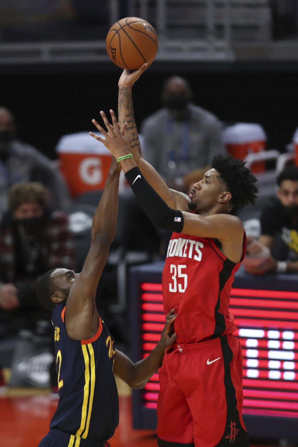 Houston Rockets center Christian Wood, right, shoots over Golden State Warriors forward Andrew Wiggins during the second half of an NBA basketball gam...