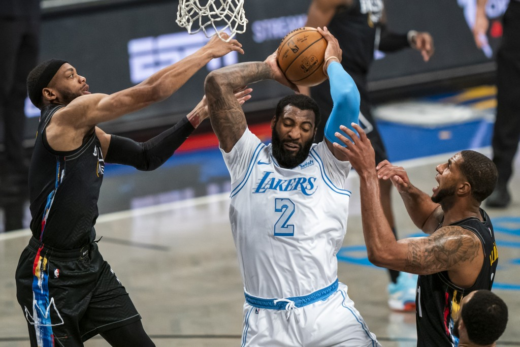 Los Angeles Lakers center Andre Drummond (2) grabs a rebound between Brooklyn Nets forward Bruce Brown, left, and center LaMarcus Aldridge during the ...