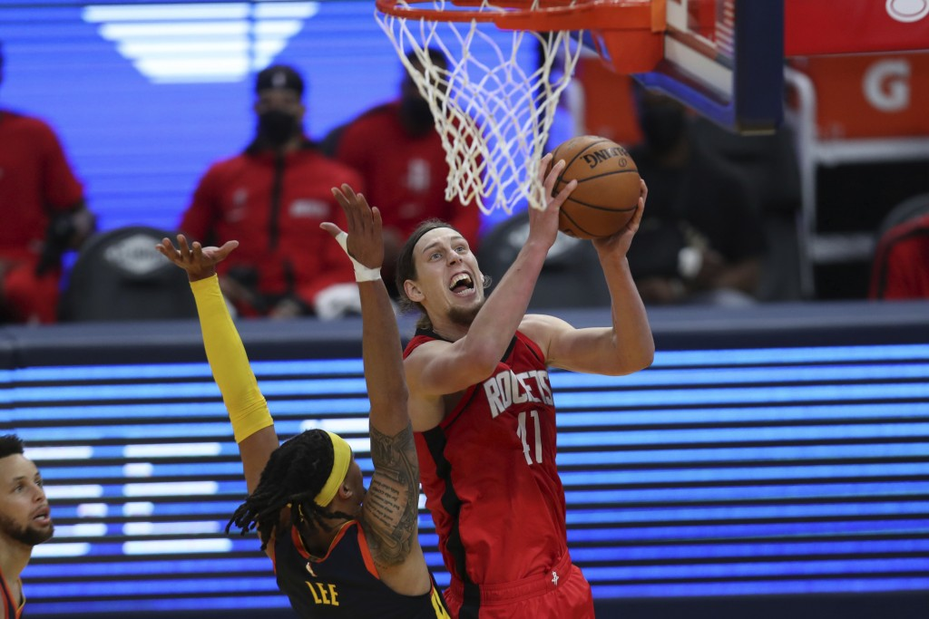 Houston Rockets center Kelly Olynyk, right, shoots against Golden State Warriors guard Damion Lee during the first half of an NBA basketball game in S...