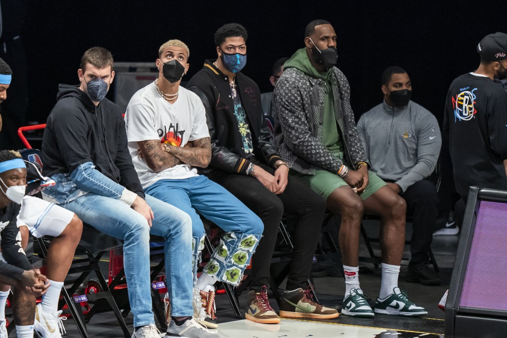 Los Angeles Lakers center Marc Gasol, forward Kyle Kuzma, forward Anthony Davis and forward LeBron James sit on the bench during the first half of the...