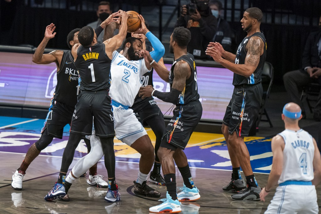 Los Angeles Lakers center Andre Drummond (2) is defended by several Brooklyn Nets during the first half of an NBA basketball game, Saturday, April 10,...