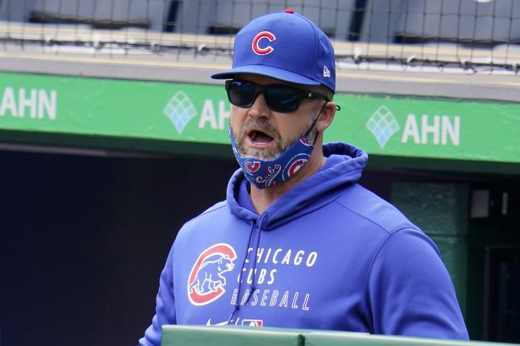 Chicago Cubs manager David Ross stands in the dugout during a baseball game against the Pittsburgh Pirates in Pittsburgh, Sunday, April 11, 2021. (AP ...