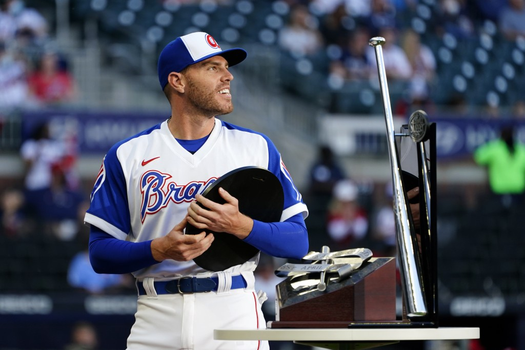 Atlanta Braves first baseman Freddie Freeman (5) holds the National League Most Valuable Player award during a ceremony before a baseball game against...