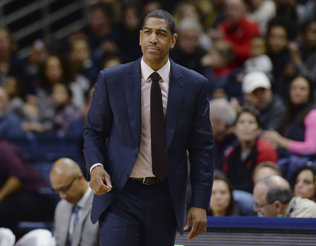 FILE - In this Feb. 25, 2018, file photo, then-Connecticut coach Kevin Ollie watches during the first half the team's NCAA college basketball game in ...