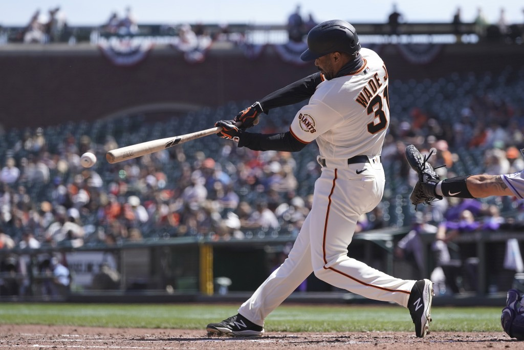 San Francisco Giants' LaMonte Wade Jr. hits a double against the Colorado Rockies during the fifth inning of a baseball game in San Francisco, Sunday,...