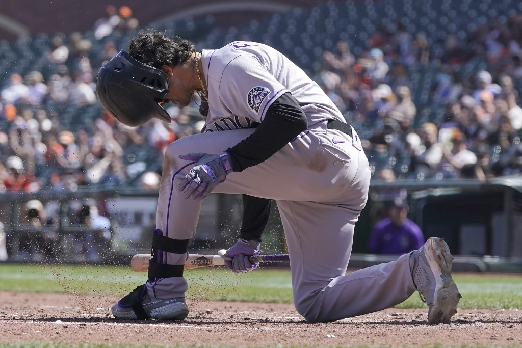 Colorado Rockies' Josh Fuentes reacts after striking out against the San Francisco Giants during the sixth inning of a baseball game in San Francisco,...