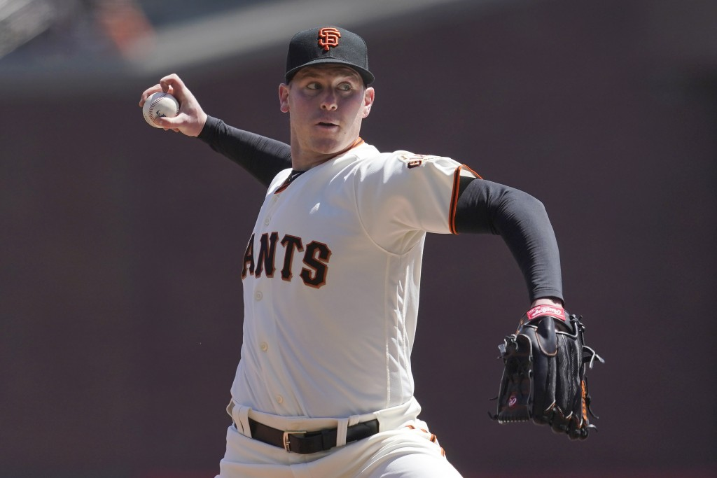 San Francisco Giants pitcher Anthony DeSclafani throws against the Colorado Rockies during the first inning of a baseball game in San Francisco, Sunda...