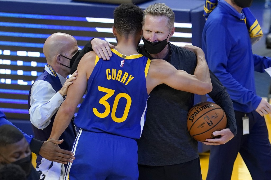 Golden State Warriors guard Stephen Curry (30) hugs head coach Steve Kerr after the Warriors defeated the Denver Nuggets in an NBA basketball game in ...