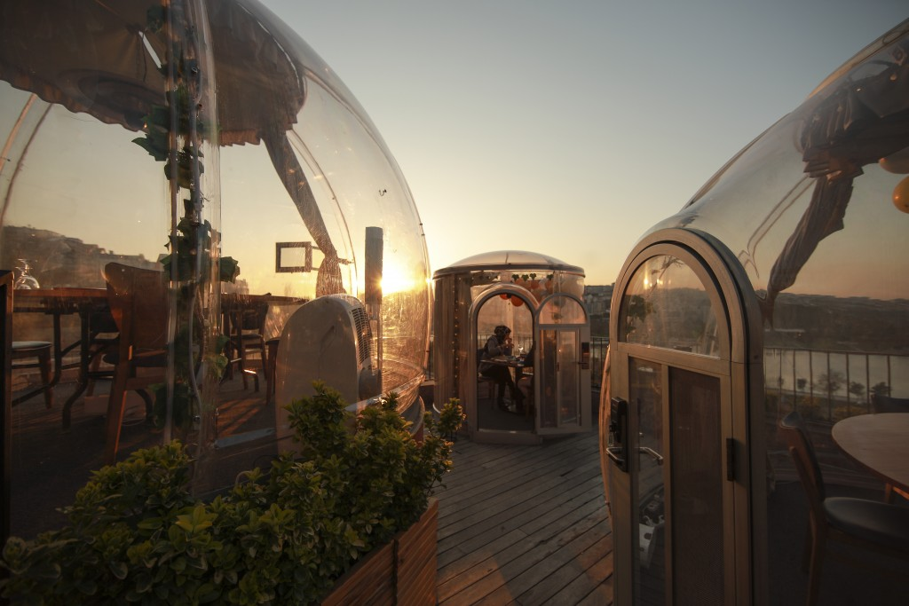 Customers enjoy their dinner specially constructed domes to ensure social distancing as a way to help stop the spread of the coronavirus, at a restaur...