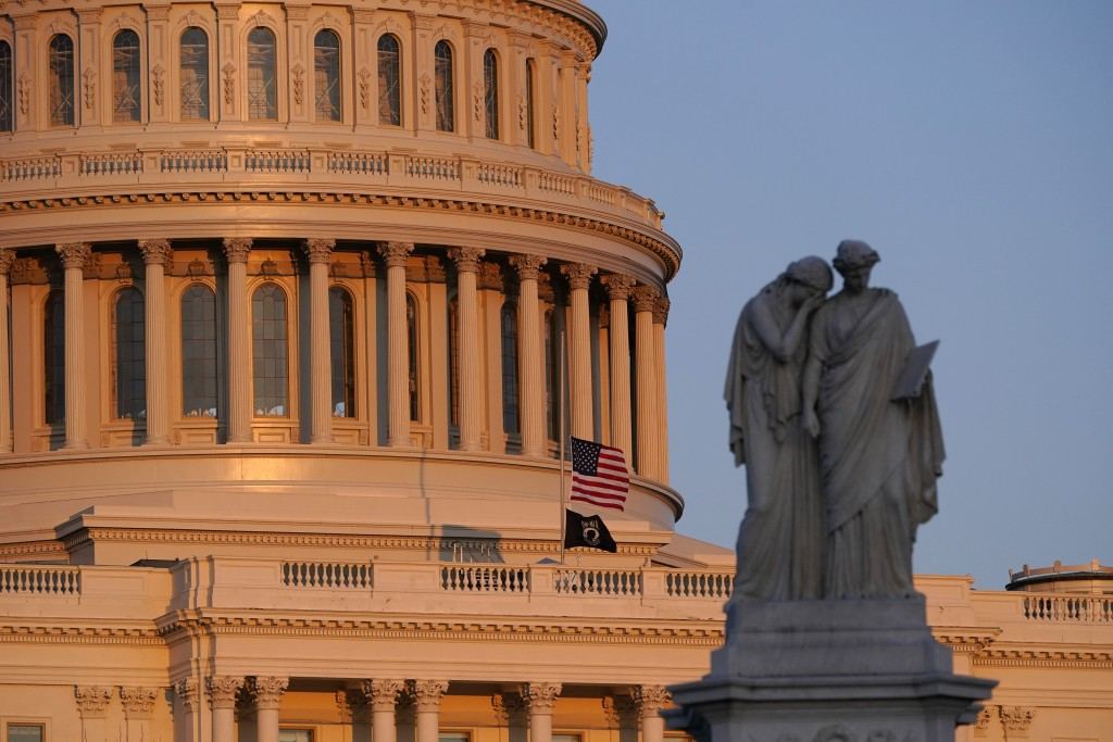 """In this April 2, 2021 photo, the American flag at the U.S. Capitol flies at half-staff in honor of Capitol Police officer William """"Billy"""" Evans who wa..."""