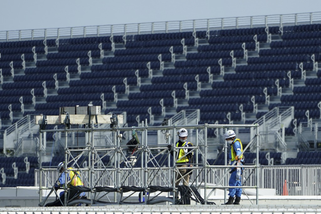 Workers prepare the venue at Kasai Canoe Slalom Centre for the Tokyo 2020 Olympics Thursday, April 8, 2021, in Tokyo. Many preparations are still up i...