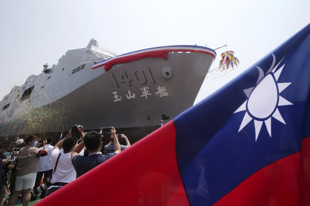 This photo shows the Yushan transport ship during a launch ceremony for its first indigenous amphibious transport dock in Kaohsiung, southern Taiwan, ...