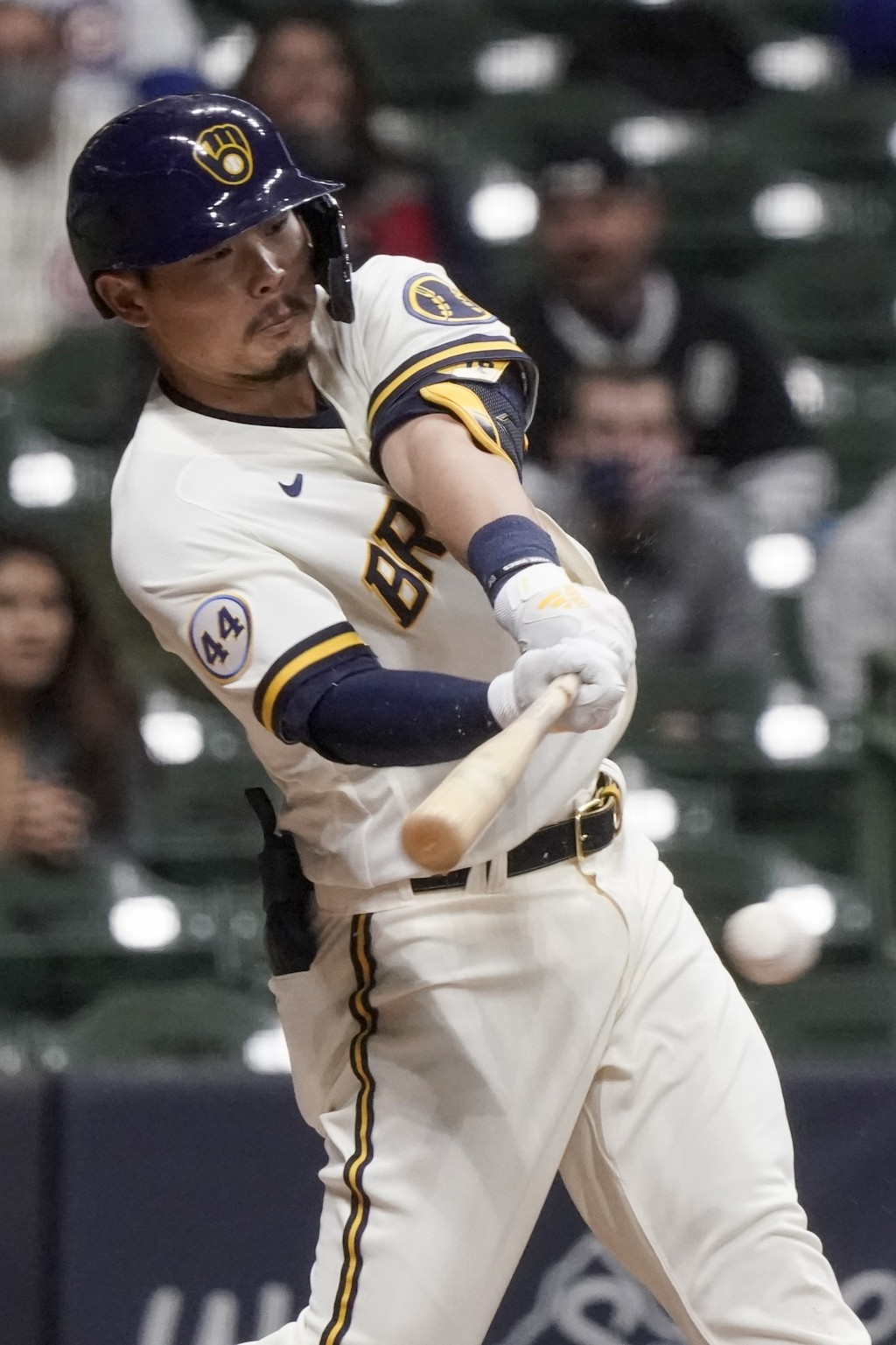 Milwaukee Brewers' Keston Hiura hits an RBI single during the sixth inning of a baseball game against the Chicago Cubs Monday, April 12, 2021, in Milw...