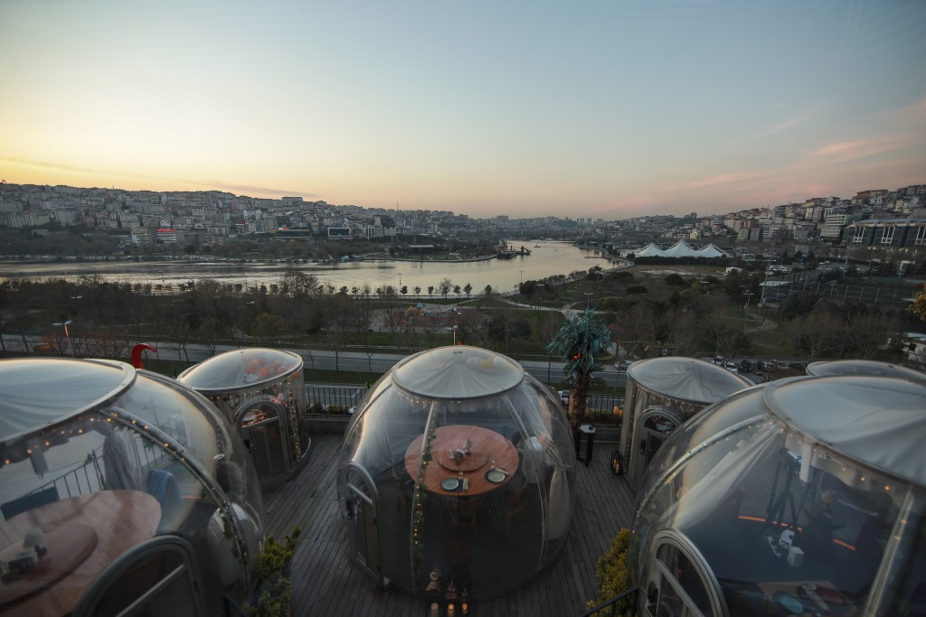 Specially constructed domes to ensure social distancing as a way to help stop the spread of the coronavirus, are placed on a terrace of a restaurant i...
