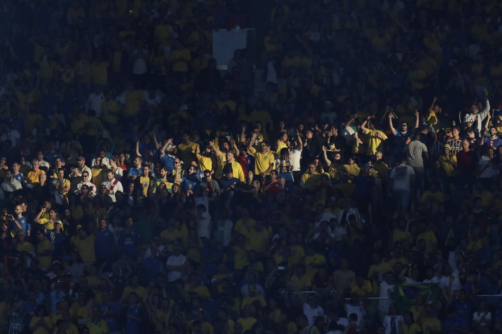 FILE - In this July 7, 2019 file photo, Brazil soccer fans cheer prior to the final match of the Copa America against Peru at Maracana stadium in Rio ...
