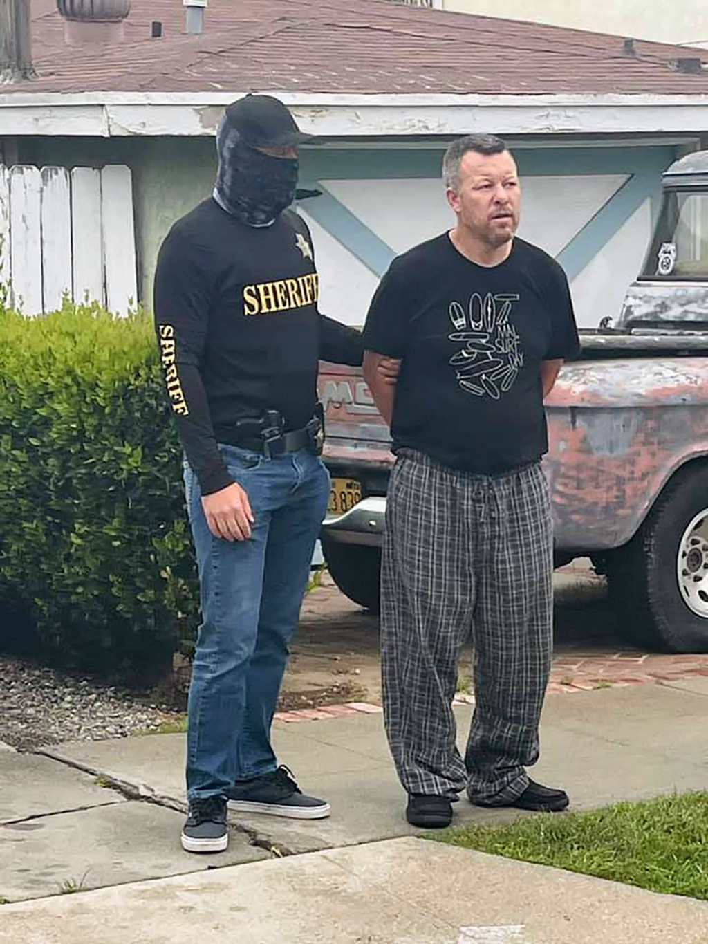 This photo provided by the San Luis Obispo County Sheriff's Office shows suspect Paul Flores who was taken into custody in the San Pedro area of Los A...
