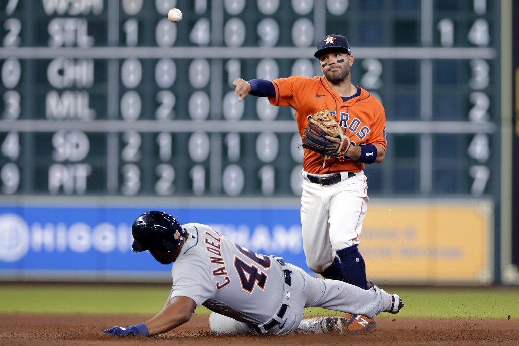 Houston Astros second baseman Jose Altuve, right, throws over Detroit Tigers' Jeimer Candelario (46) to complete a double play on Wilson Ramos during ...