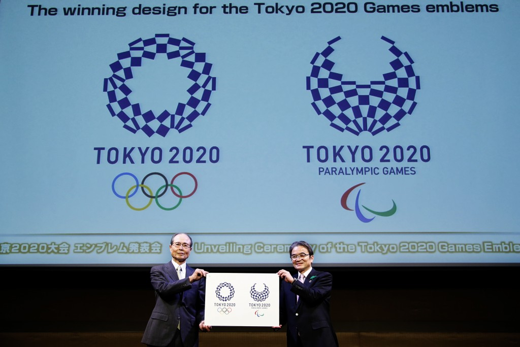 FILE - In this April 25, 2016, file photo, Tokyo 2020 Emblems Selection Committee Chairperson Ryohei Miyata, right, and its member and Japanese baseba...