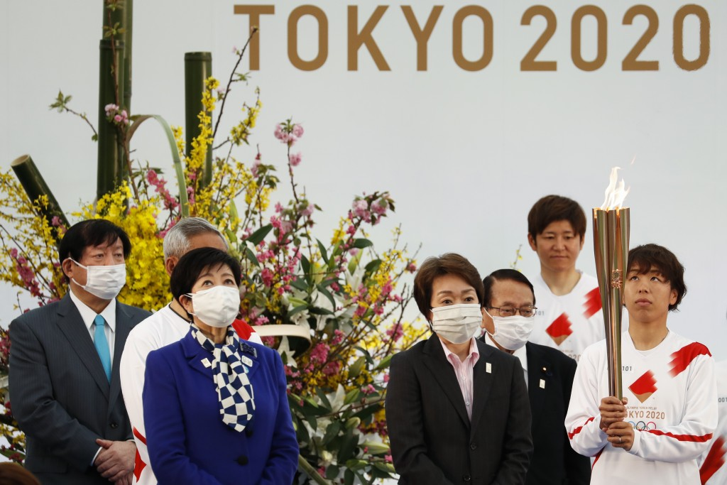 FILE -  In this March 25, 2021, file photo, Tokyo Gov. Yuriko Koike, third from left, and Tokyo 2020 Organizing Committee President Seiko Hashimoto, f...