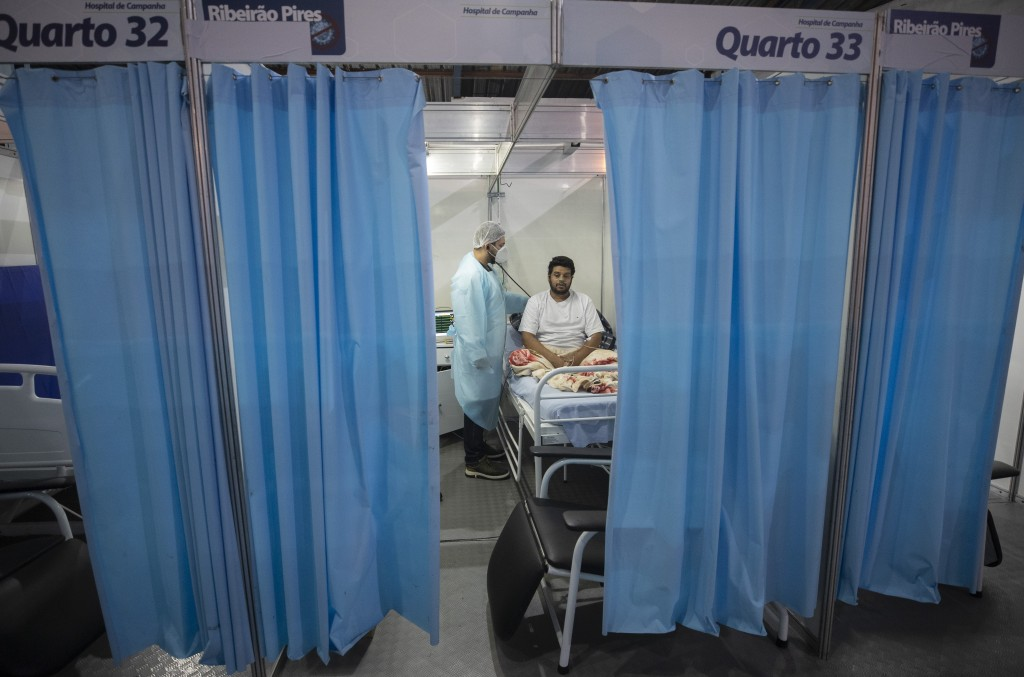 Doctor Malek Imad treats 34-year-old COVID-19 patient Everton Barbosa Godoy at the emergency unit of a field hospital in Ribeirao Pires, greater Sao P...