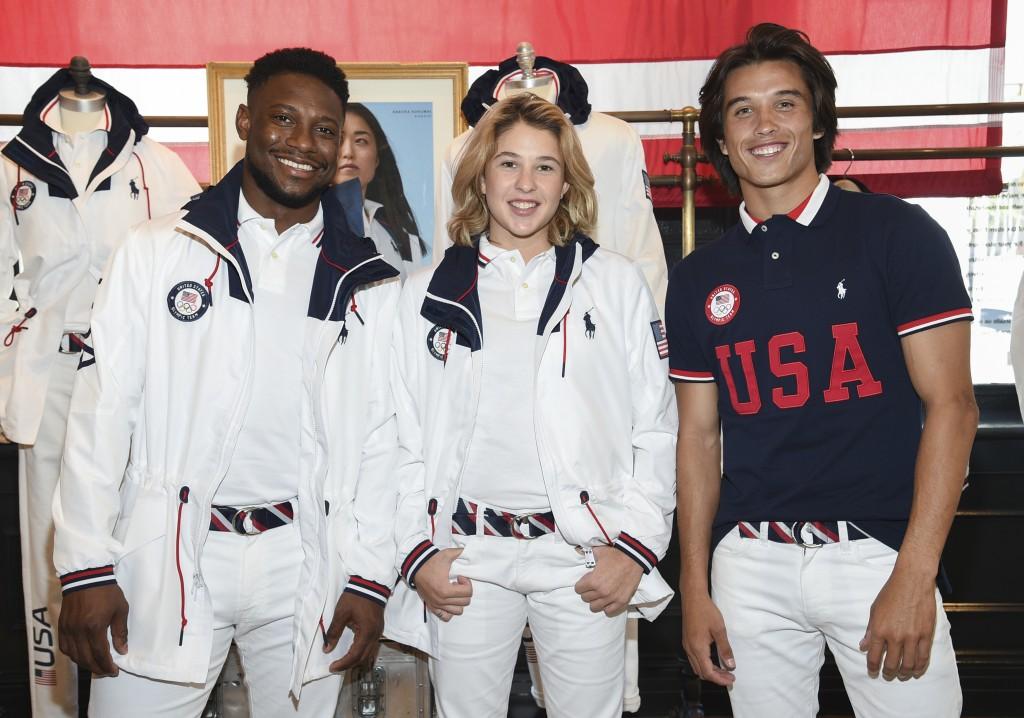 Athletes Daryl Homer (Fencing), left, Jordyn Barratt (Skateboard) and Heimana Reynolds (Skateboard) participate in the Team USA Tokyo Olympic closing ...