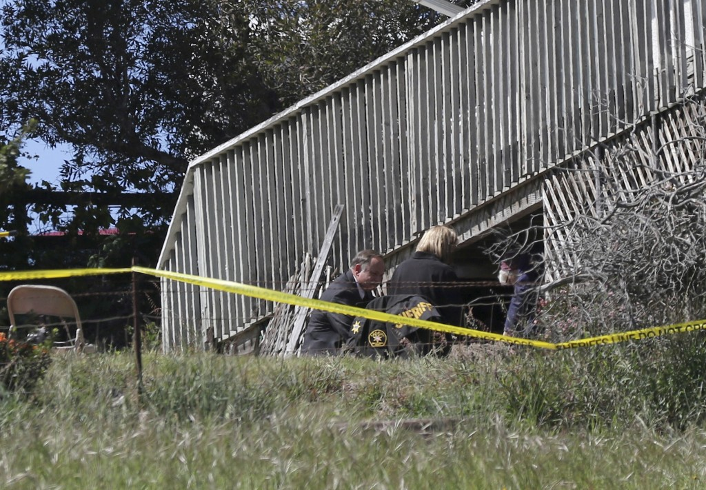 FILE - In this March 16, 2021, file photo, San Luis Obispo Sheriff's Office personnel dig in an area in the backyard of the home of Ruben Flores, in A...