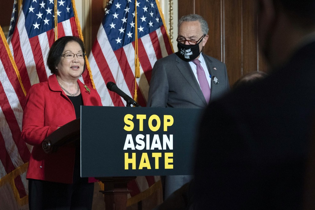 Sen. Mazie Hirono, D-Hawaii, accompanied by Senate Majority Leader Chuck Schumer, D-N.Y., speaks during a news conference on Capitol Hill, in Washingt...