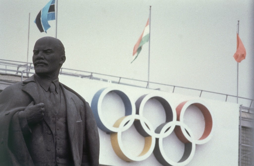 FILE - Lenin Stadium, the main stadium for the 1980 Moscow Summer Olympic Games and a Lenin statue are shown in this July, 1980 file photo. Just to he...