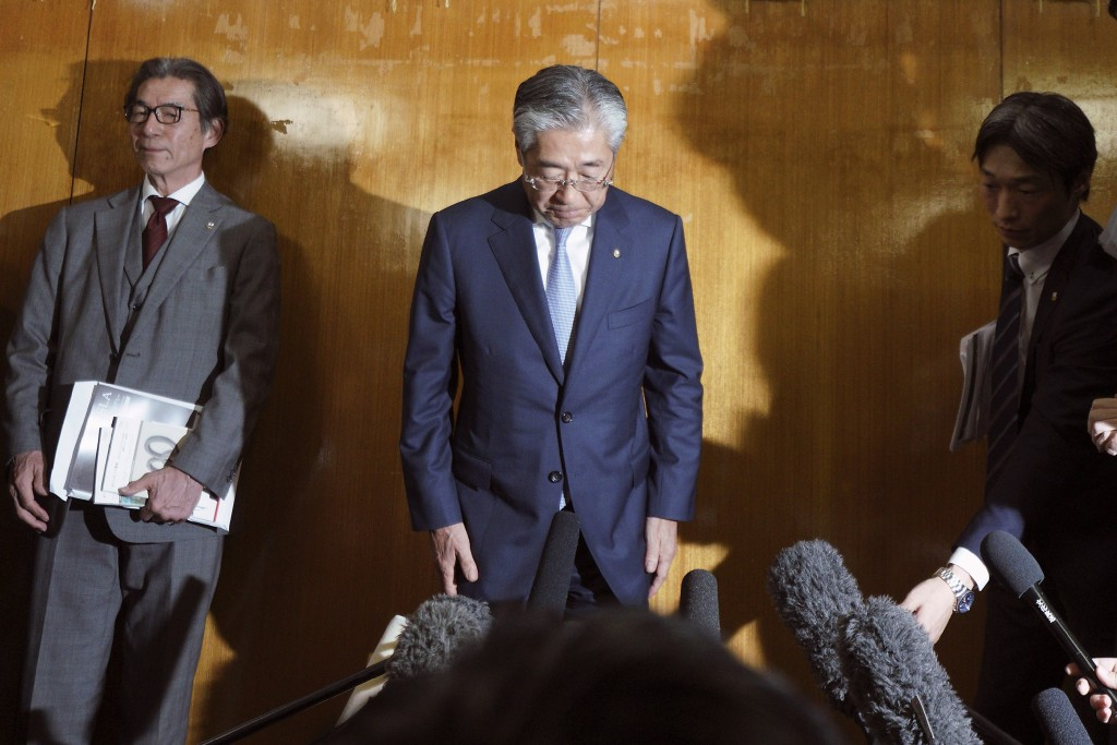 FILE - In this March 19, 2019, file photo, International Olympics Committee member and head of the Japanese Olympic Committee Tsunekazu Takeda bows as...