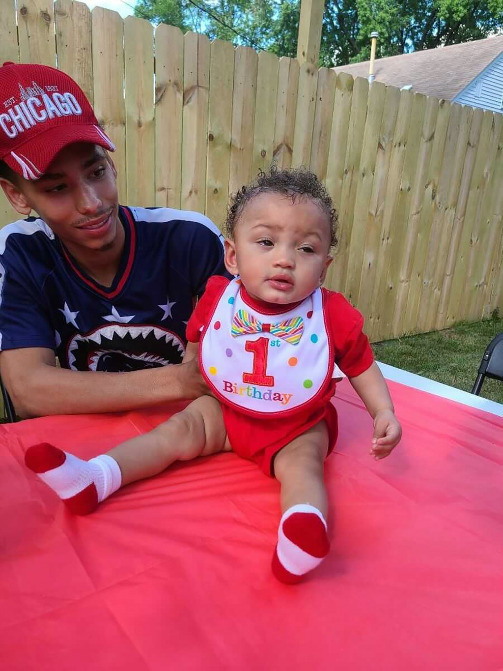This photo provided by Ben Crump Law, PLLC. shows Daunte Wright and his son Daunte Jr., at his first birthday party. A white police officer who fatall...