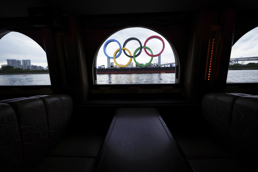 The Olympic rings floating in the water in the Odaiba section are seen from a window of a water bus Monday, April 12, 2021, in Tokyo. Tokyo pitched it...