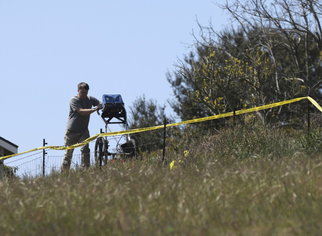 FILE - In this March 16, 2021, file photo, an investigator uses ground penetrating radar to search the backyard of the home of Ruben Flores, in Arroyo...