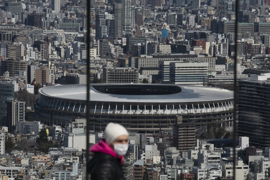 FILE - In this March 3, 2020, file photo, the New National Stadium, a venue for the opening and closing ceremonies at the Tokyo 2020 Olympics, is seen...