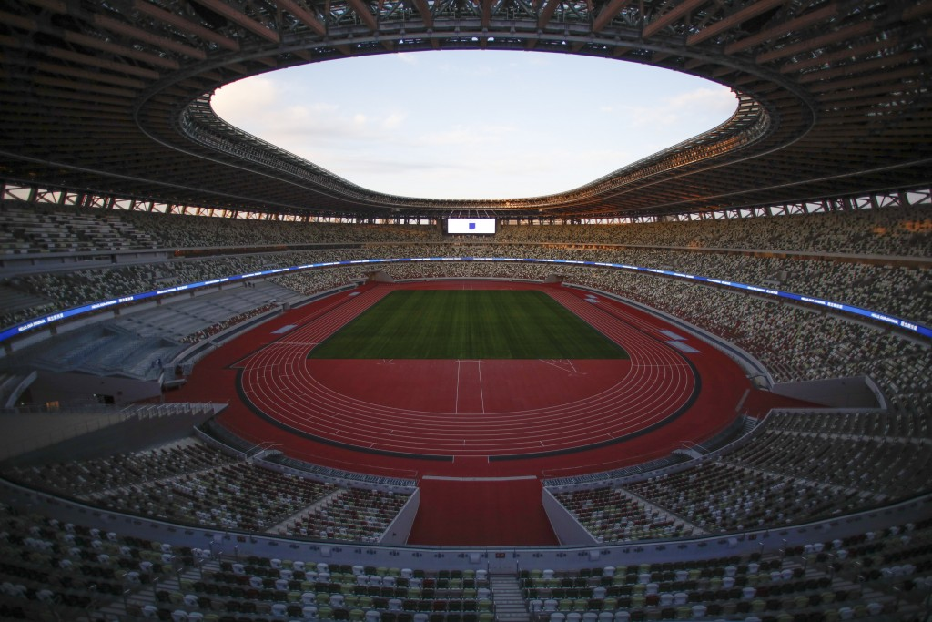 """FILE - This Dec. 15, 2019, file photo shows the Japan National Stadium in Tokyo. Tokyo pitched itself as """"a safe pair of hands"""" when it was awarded th..."""