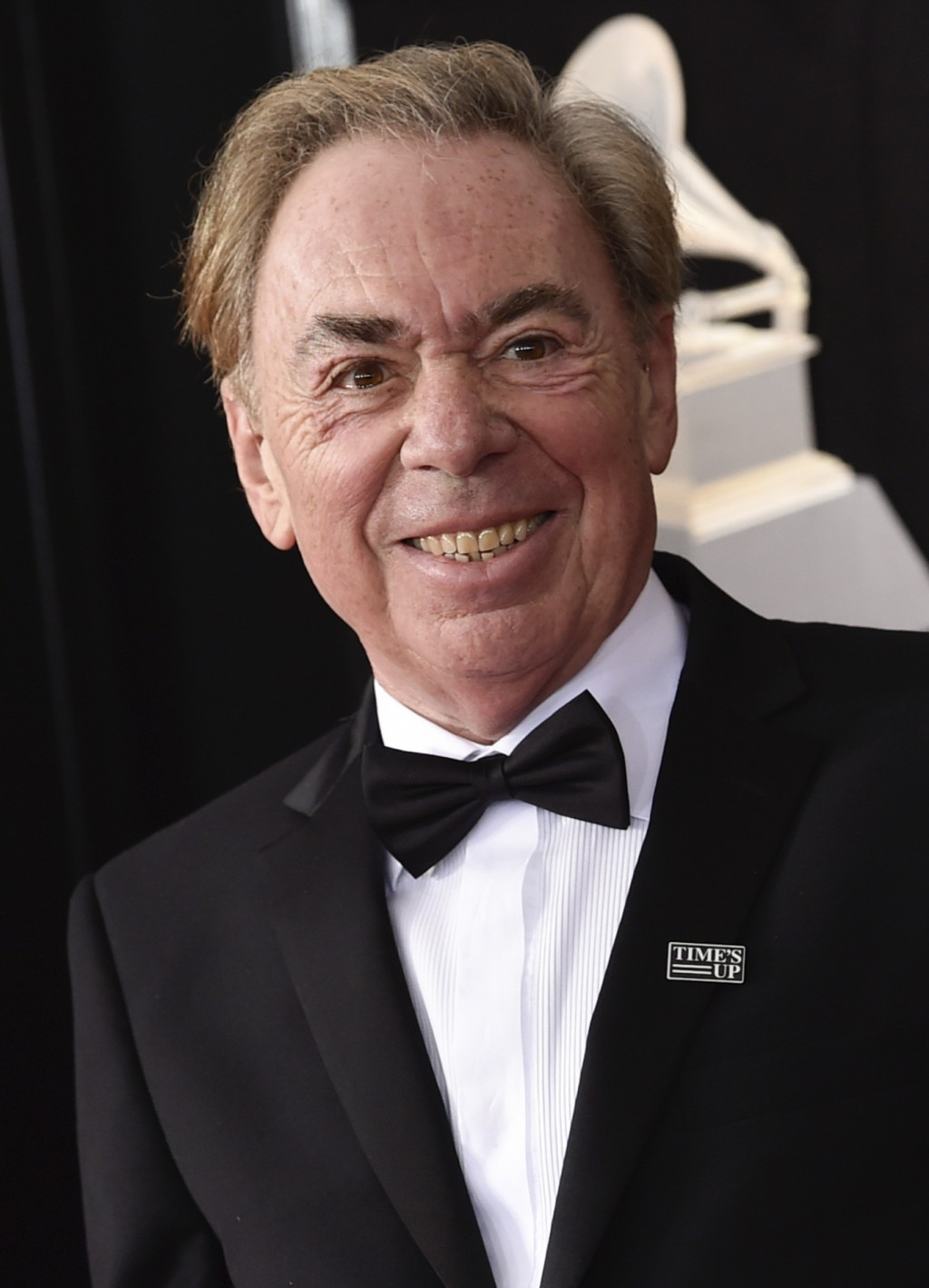 """FILE - Composer Andrew Lloyd Webber arrives at the 60th annual Grammy Awards in New York on Jan. 28, 2018. A key prop from the smash musical """"The Phan..."""