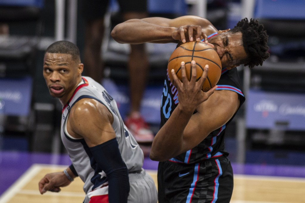 Sacramento Kings center Hassan Whiteside (20) reacts after getting fouled by Washington Wizards guard Russell Westbrook (4) during the second quarter ...