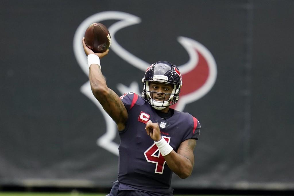 FILE - In this Dec. 27, 2020, file photo, Houston Texans quarterback Deshaun Watson throws a pass during an NFL football game against the Cincinnati B...