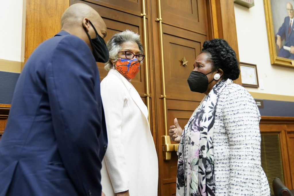 Rep. Joyce Beatty, D-Ohio, center, listens as Rep. Sheila Jackson Lee, D-Tex., right, chair of the Subcommittee on Crime, Terrorism, and Homeland Secu...