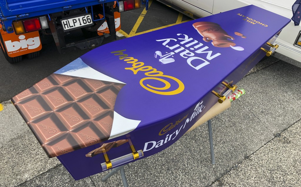 This photo provided by Ross Hall, shows a chocolate bar designed casket in Auckland, New Zealand on April 30, 2020. Auckland company Dying Art makes u...