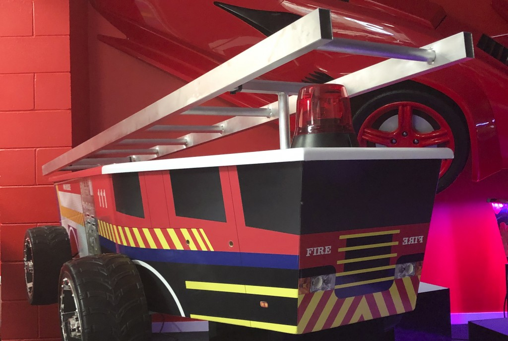 This photo provided by Ross Hall, shows a casket in the design of a fire engine in Auckland, New Zealand Feb. 5, 2019. Auckland company Dying Art make...