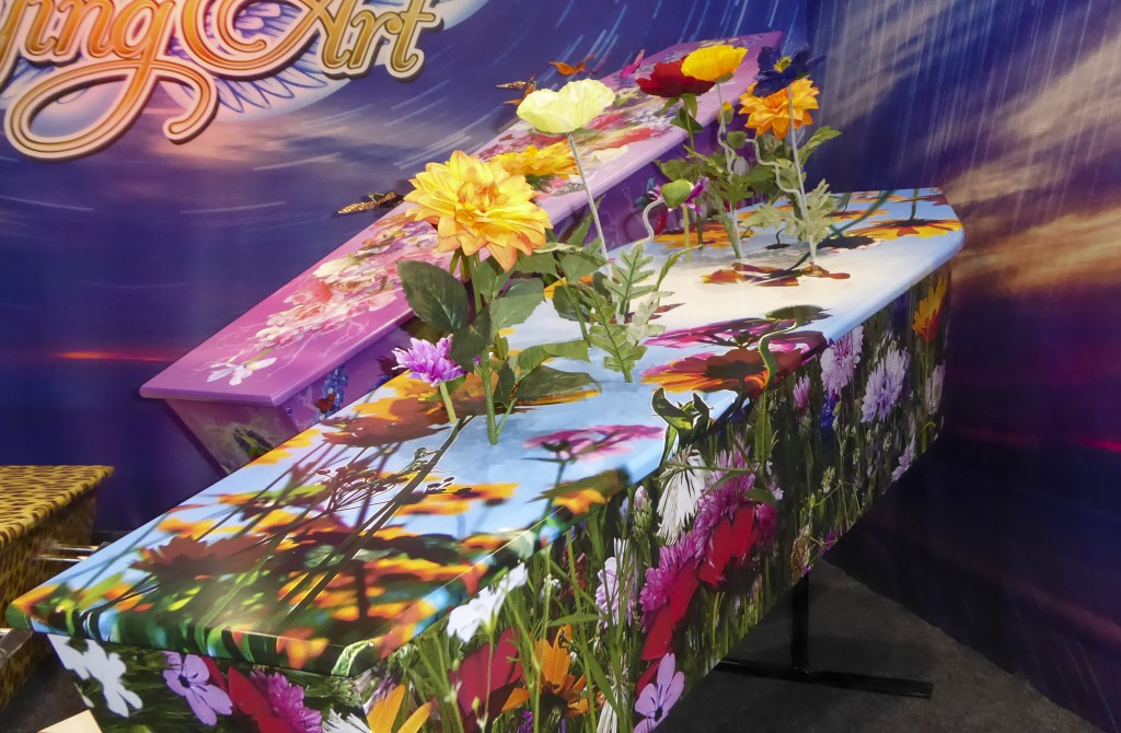 This photo provided by Ross Hall, shows floral designed caskets in Auckland, New Zealand March 17, 2016. Auckland company Dying Art makes unique custo...
